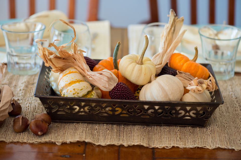 fall centerpiece with pumpkins and gourds