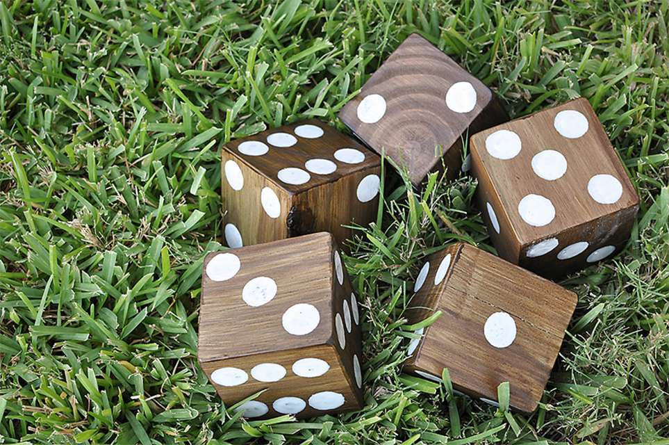 Wooden dice in a yard