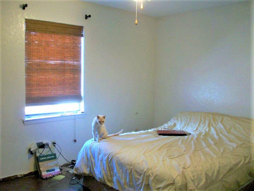 Dormitorio antes del cambio de imagen con sombra de ventana