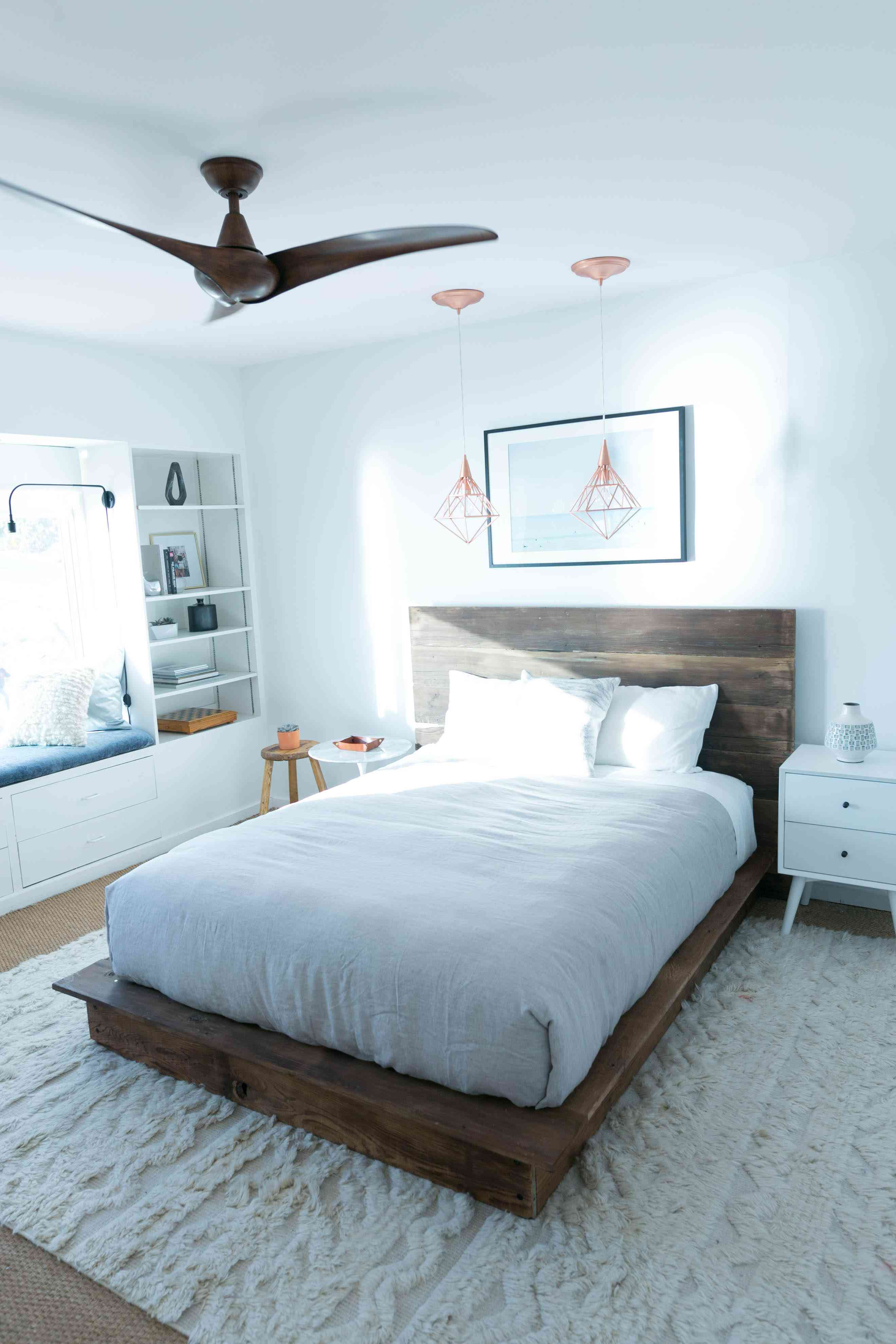A bedroom with a platform bed in it