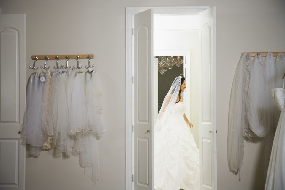 bride in wedding gown at dress shop