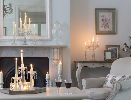 living room with lots of burning candles