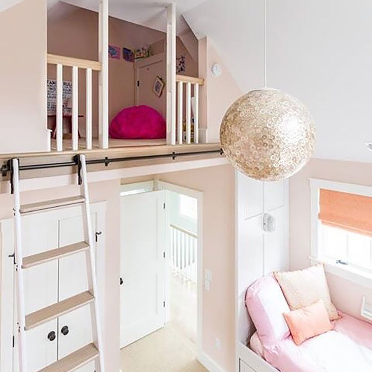 A girl's loft with a hangout nook at the top and a bedroom on the bottom.