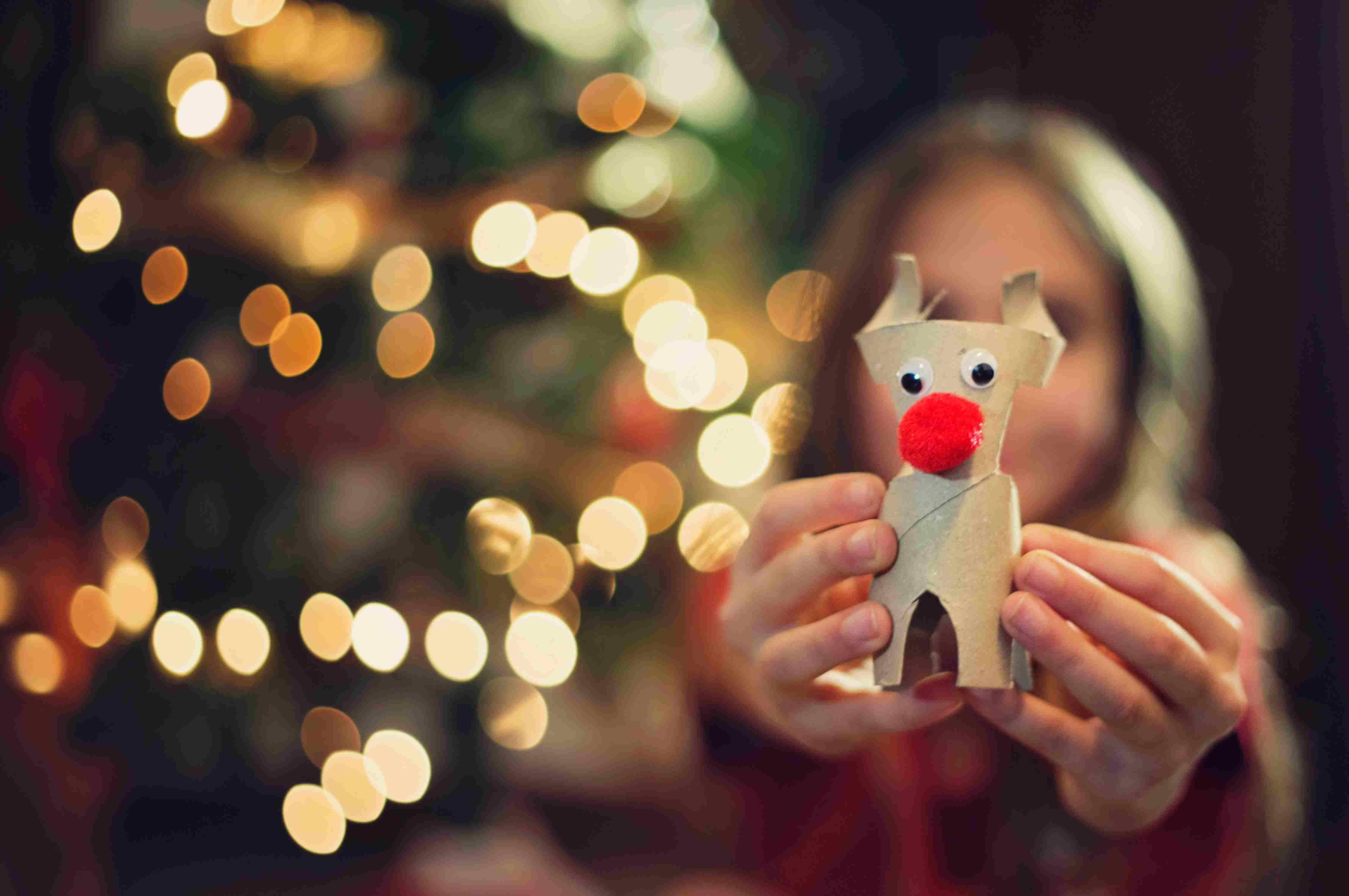 Rudolf. A handmade Christmas ornament in girl hand