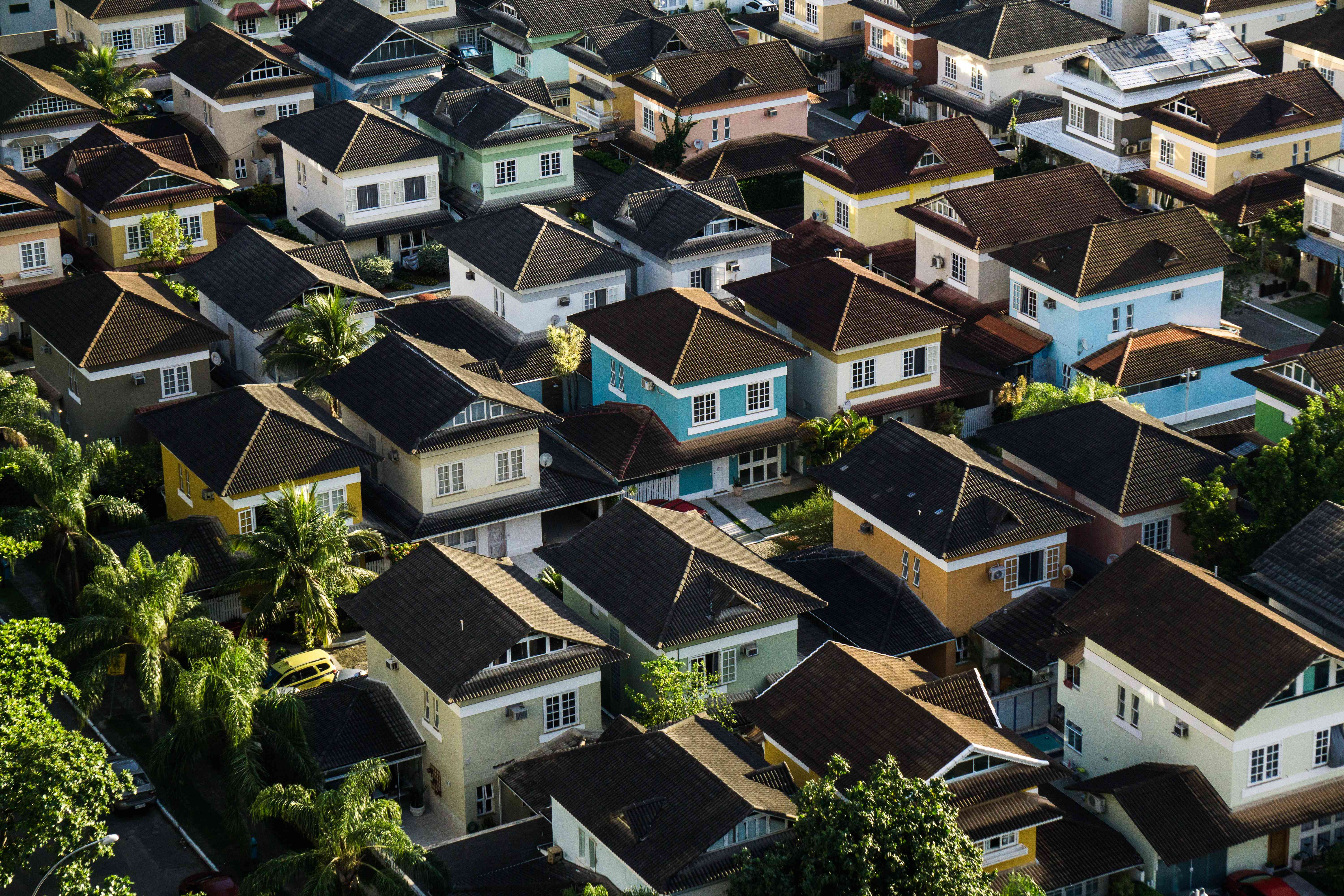 an aerial view of a colorful neighborhood of homes