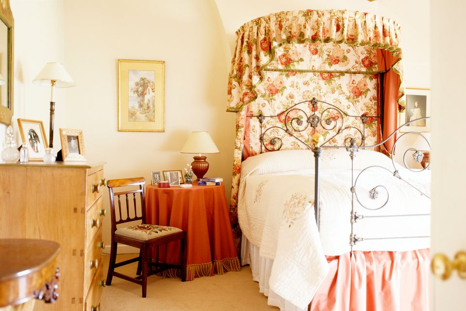 pretty bedroom with a bed crown canopy