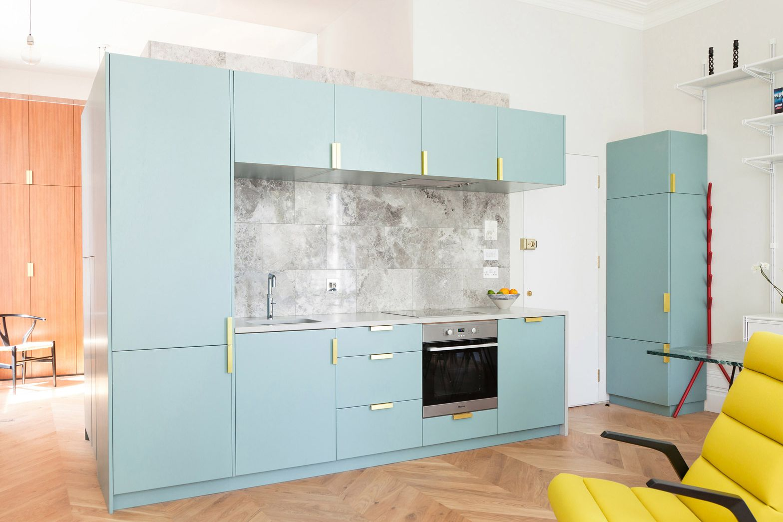 Pale blue cabinets with gold handles