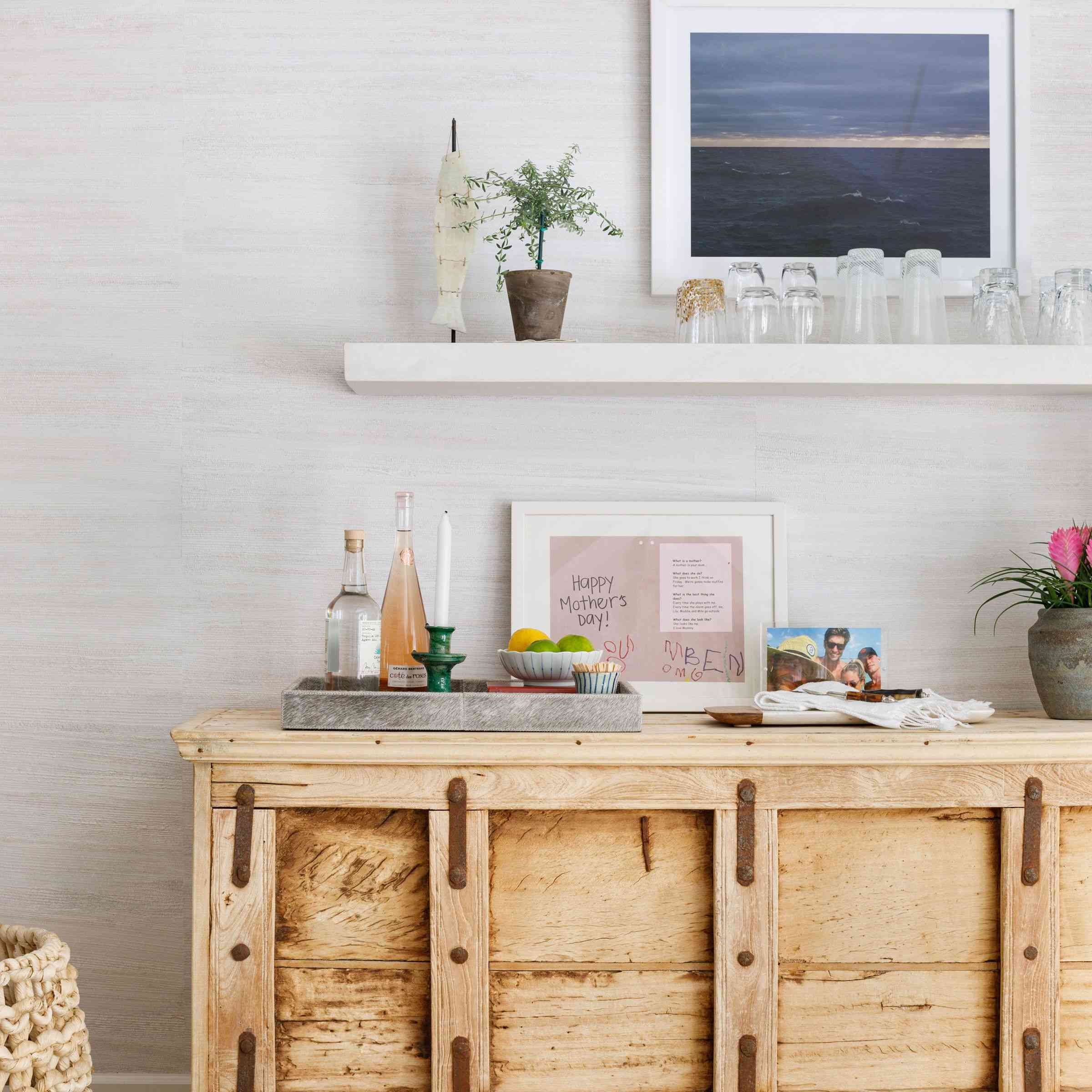 Rustic credenza with modern decor above by Andrea Goldman Design