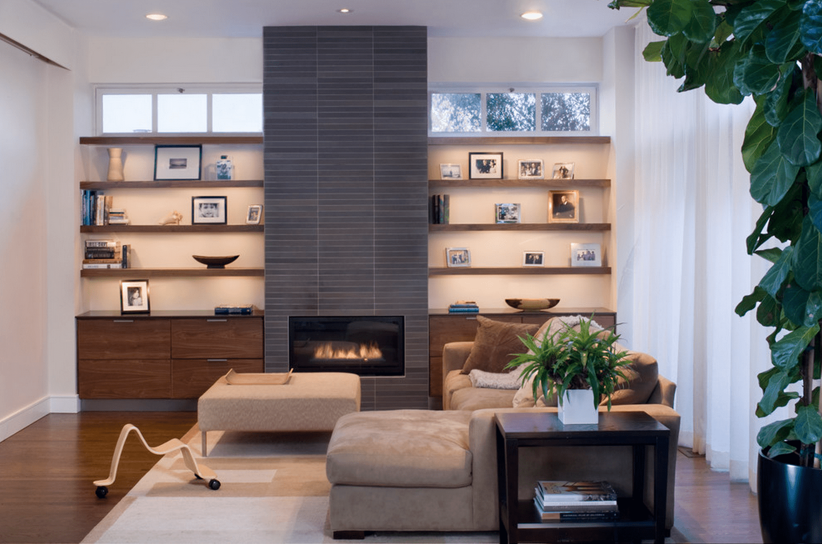 Floor to ceiling fireplace feature with built-in shelving