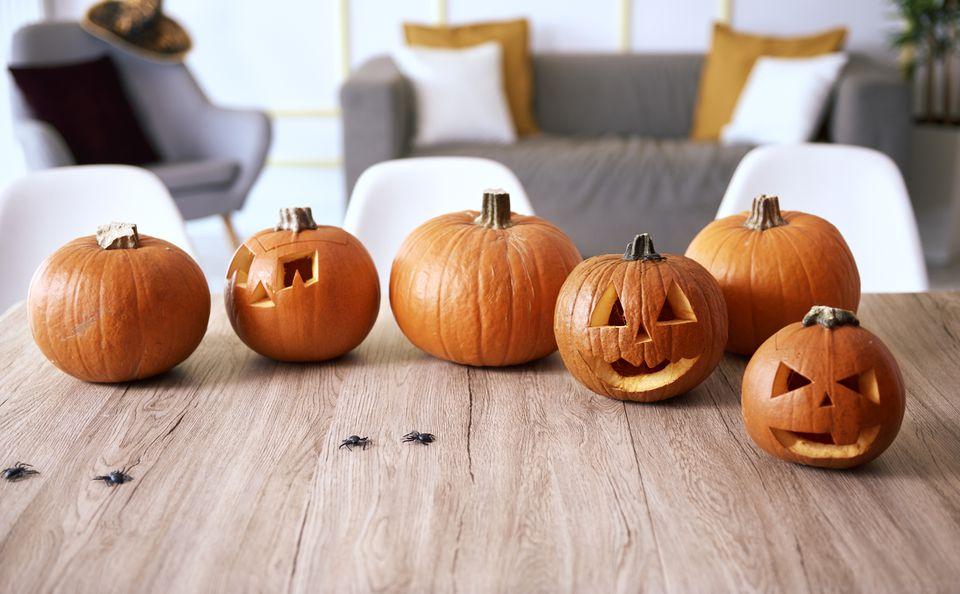Halloween pumpkins on wooden table