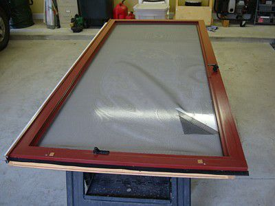 A screen door being repaired