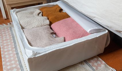 under the bed storage bin holding sweaters