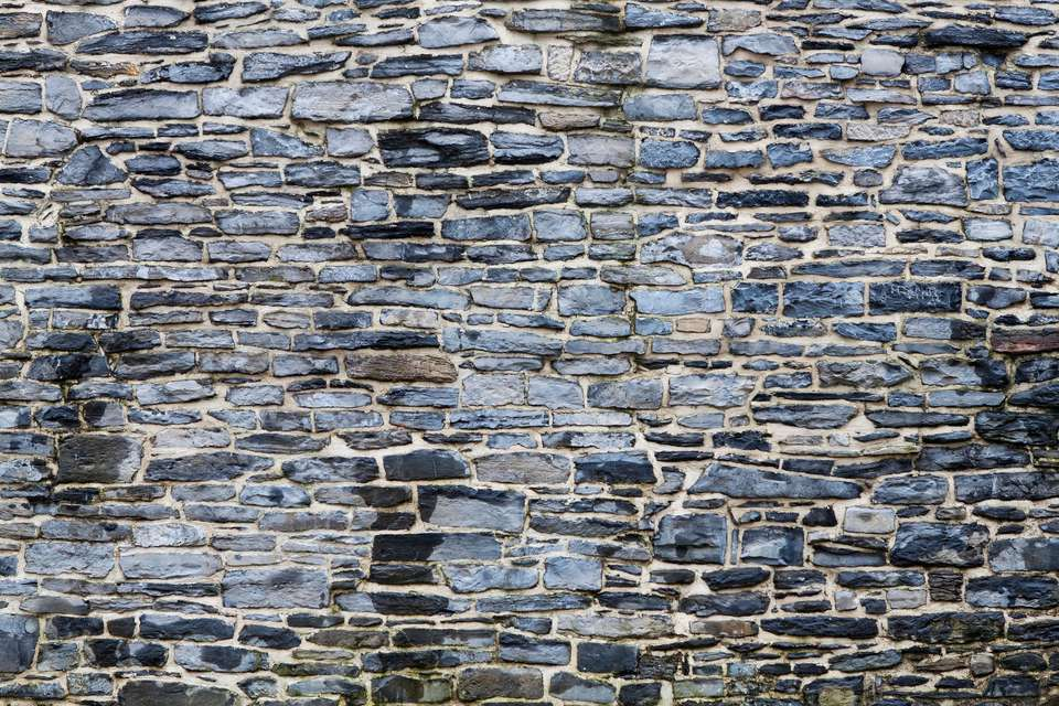 Mortared stone wall