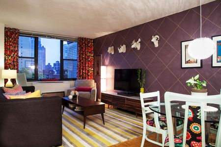 Living Room With A Dark Purple Accent Wall