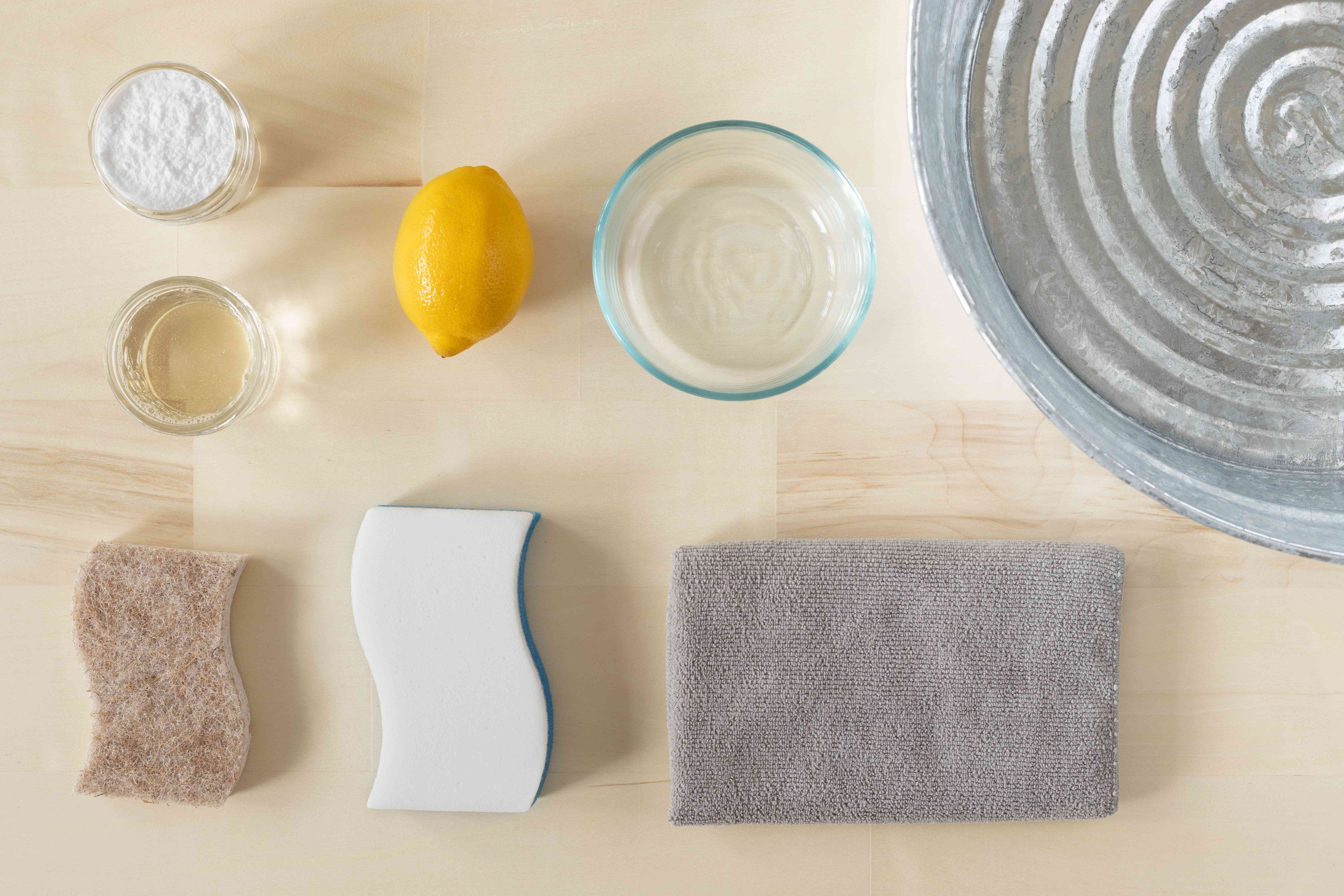 Materials and tools to clean microwave with lemons
