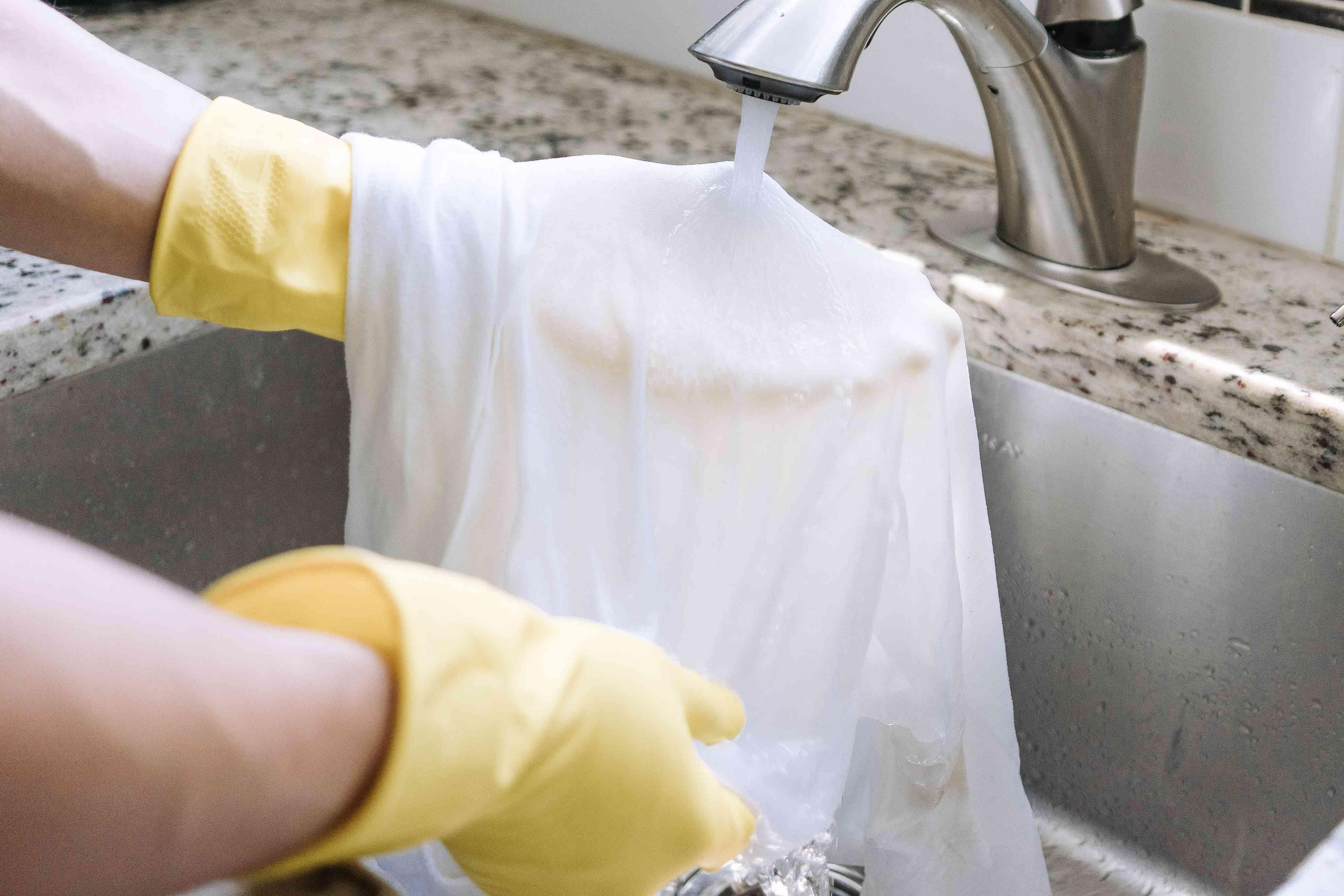 flushing a garment under water