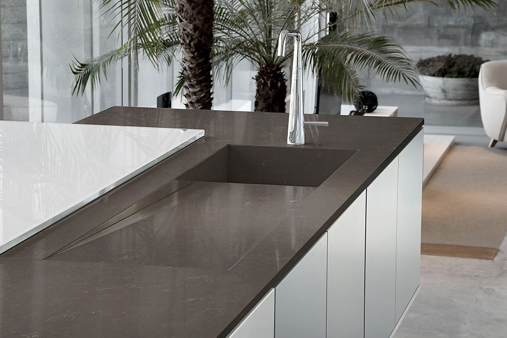 Calyso by Silestone on kitchen island with sink.