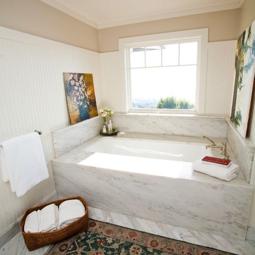 A bathroom with beadboard up the walls and on the ceiling