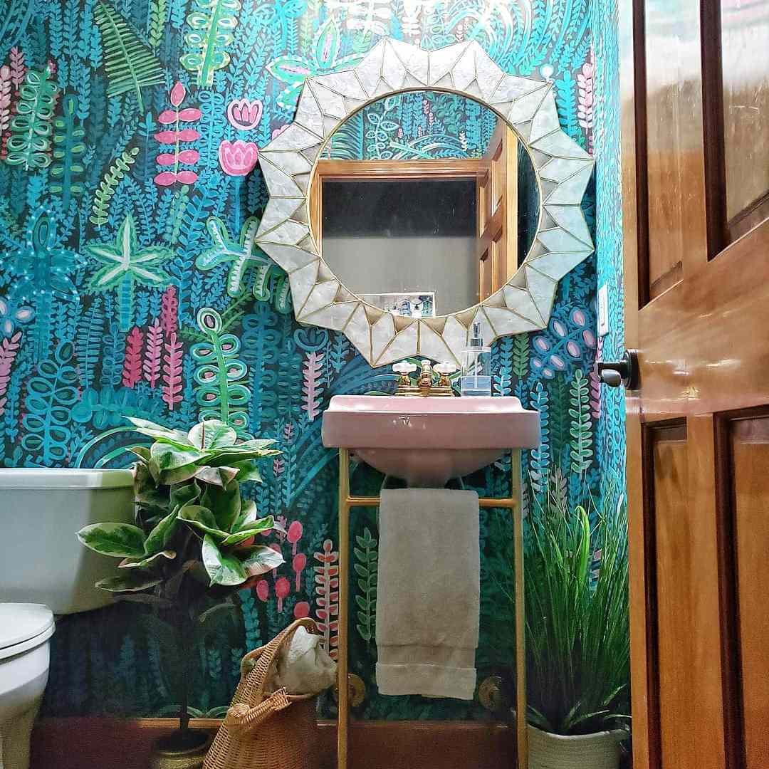 Bathroom with bold wallpaper and pink sink