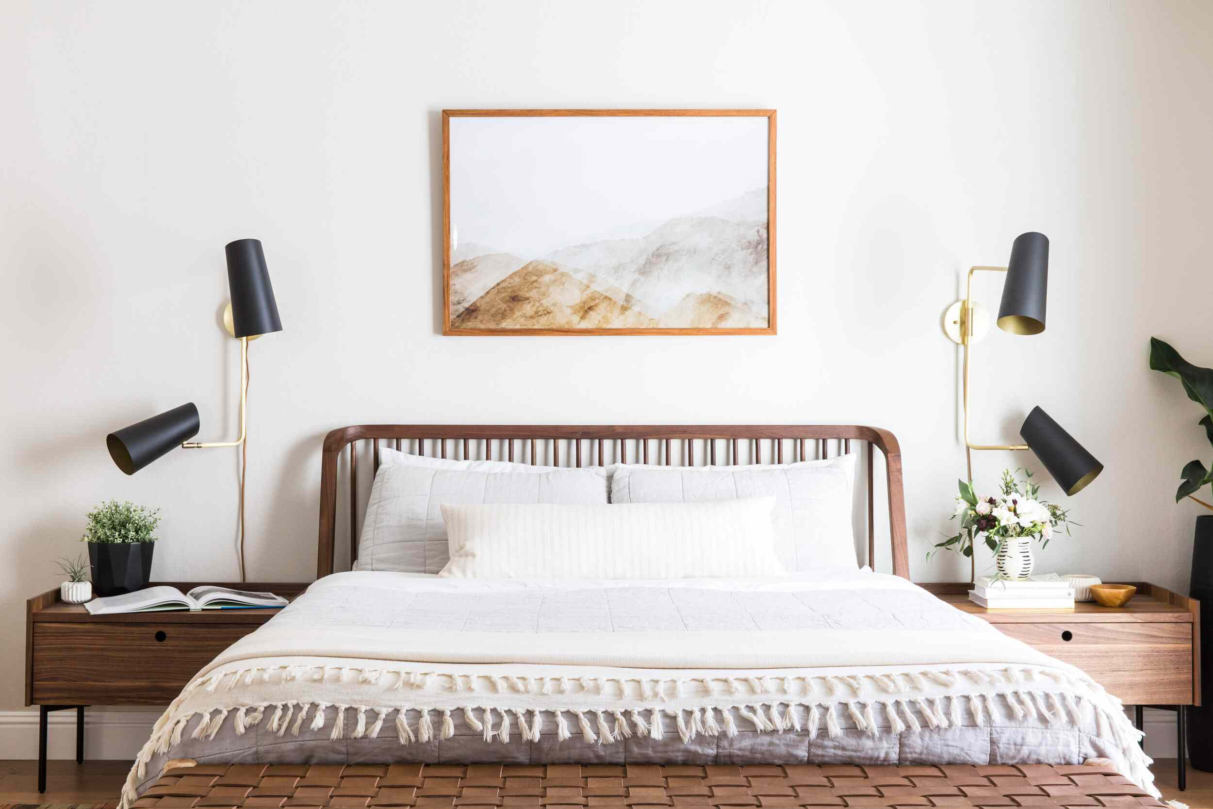 Guest bedroom with fresh flowers on nightstand