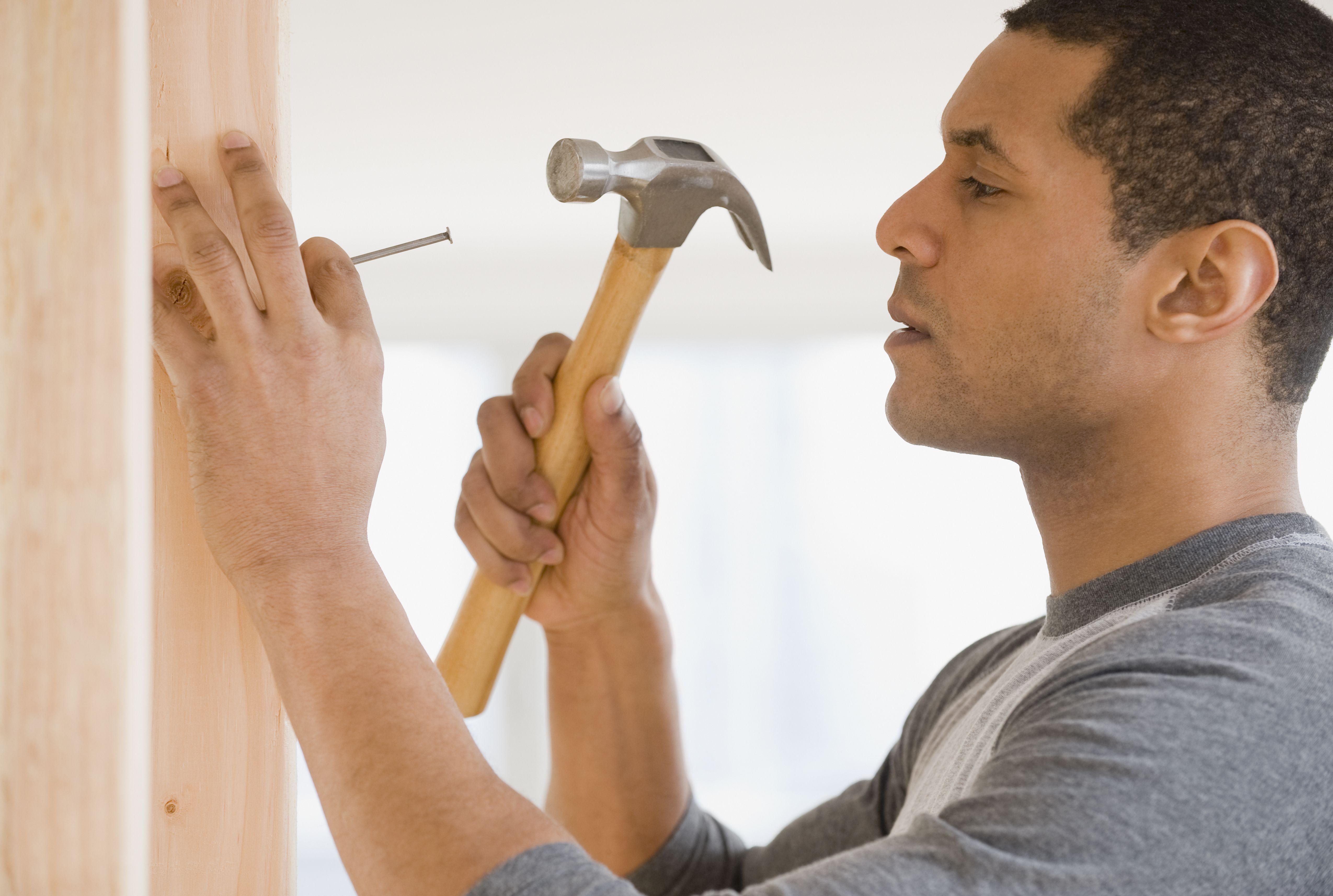 African man hammering nail