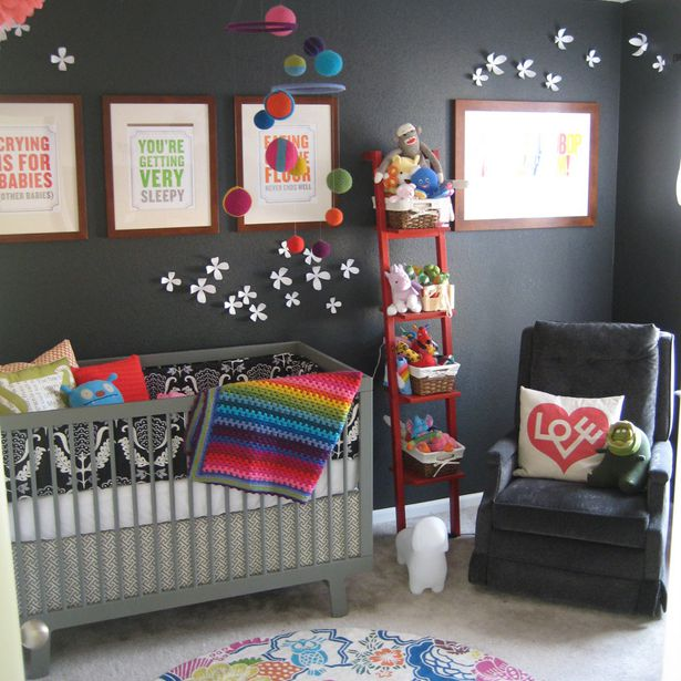 Black and white nursery with colorful rainbow accents