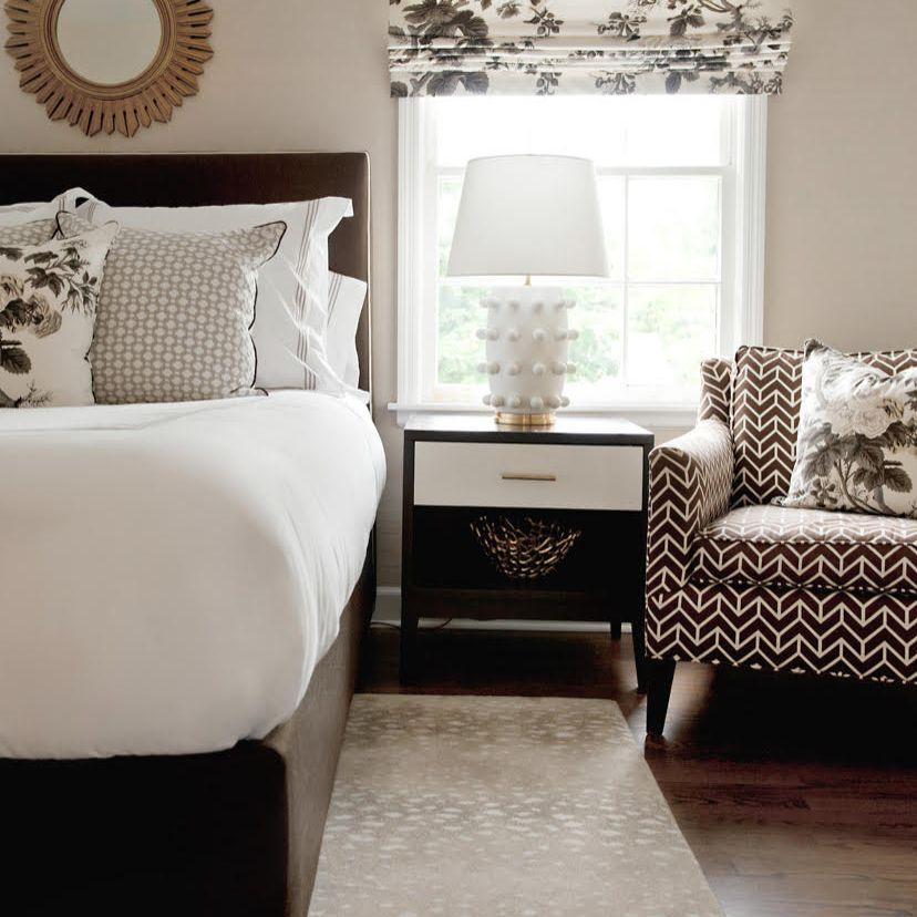 Interior designer Ashley Colombo has one of Kelly Weartsler's famed Linden lamps in a bedroom in her home