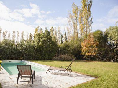 Deckchairs at poolside in garden