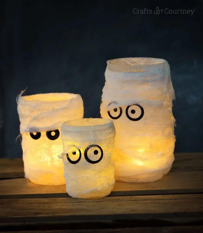 Glowing jars with mummy eyes