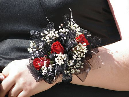 Red and black corsage