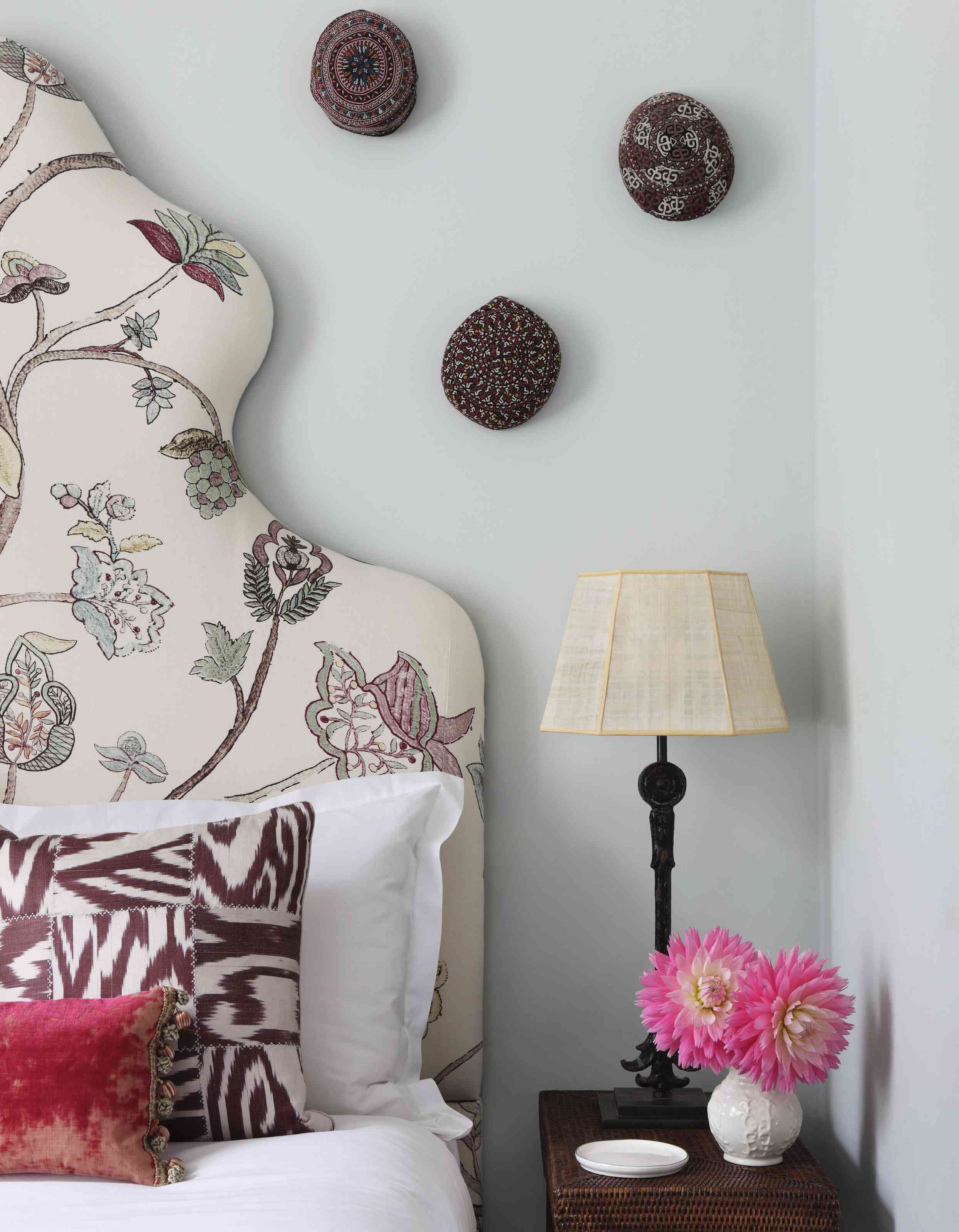 bed with maroon decorative touches