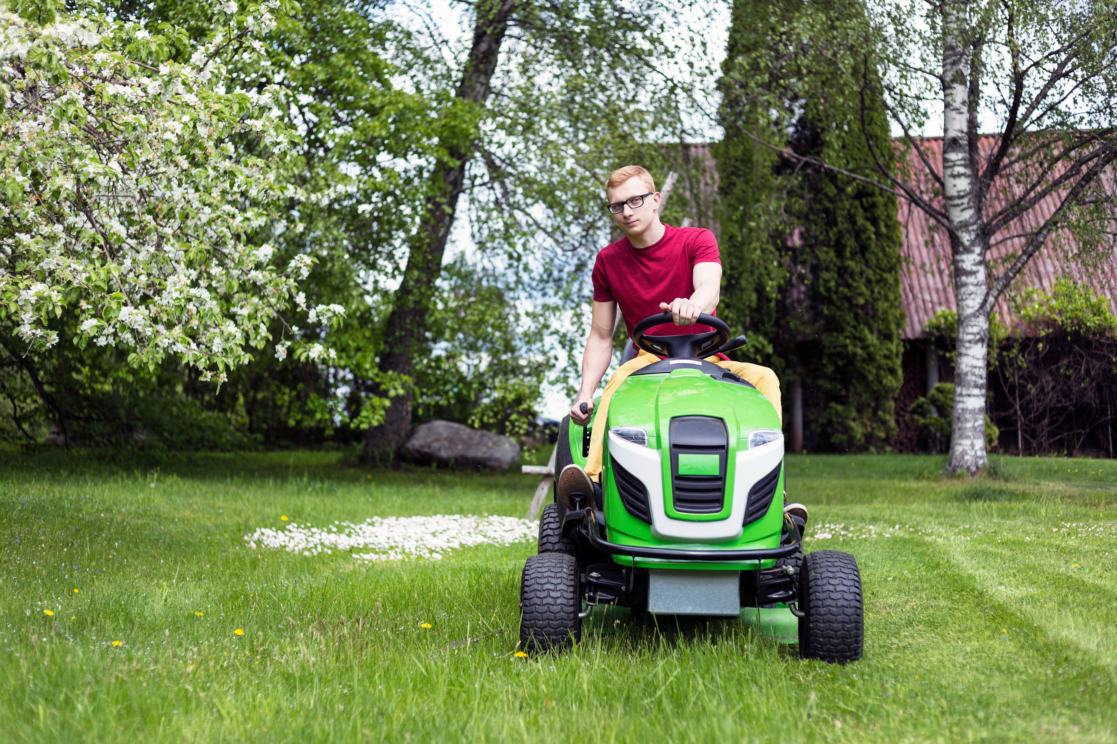 gardener using lawn tractor