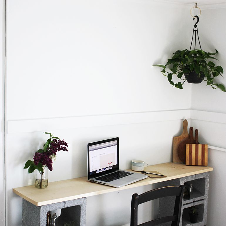 A desk built out of cinder blocks in a living room