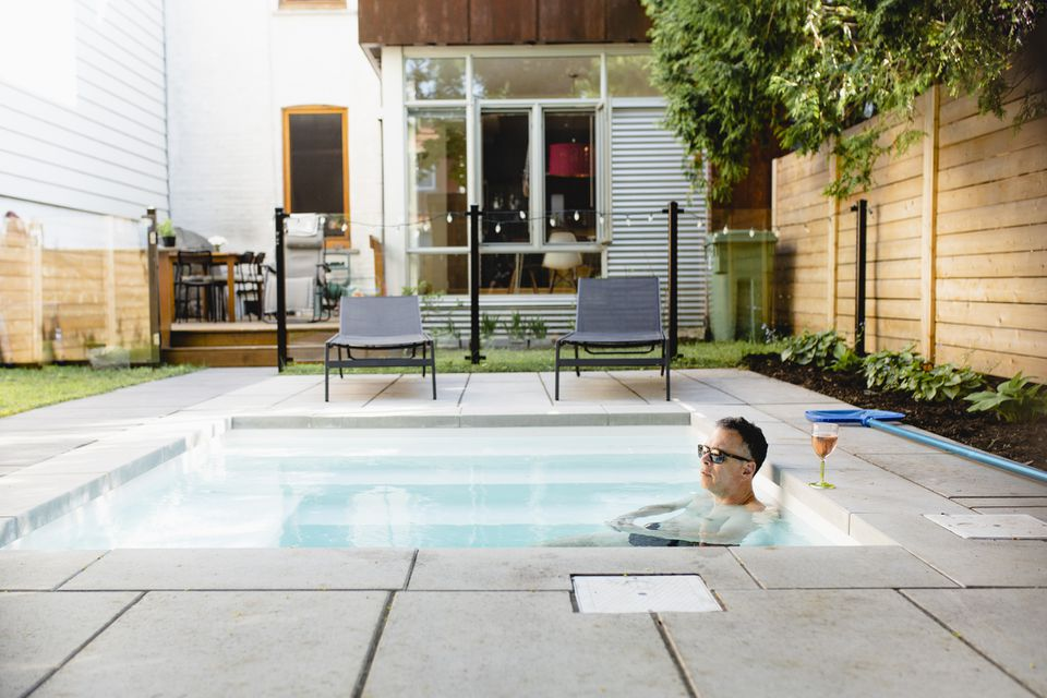man in small pool