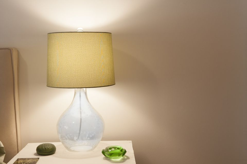 Glass lamp on bedroom side table