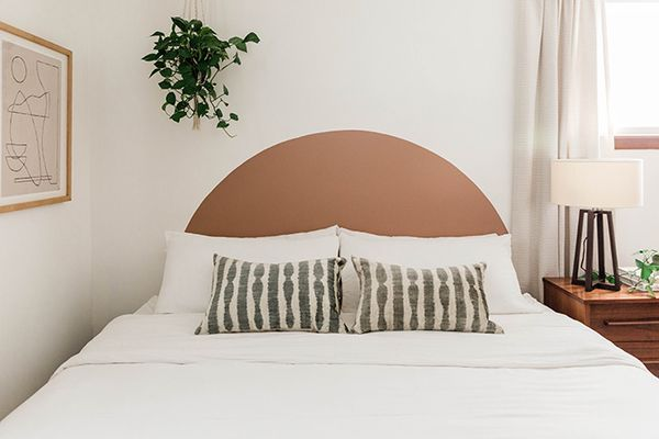 Painted arch over a bed like a headboard.