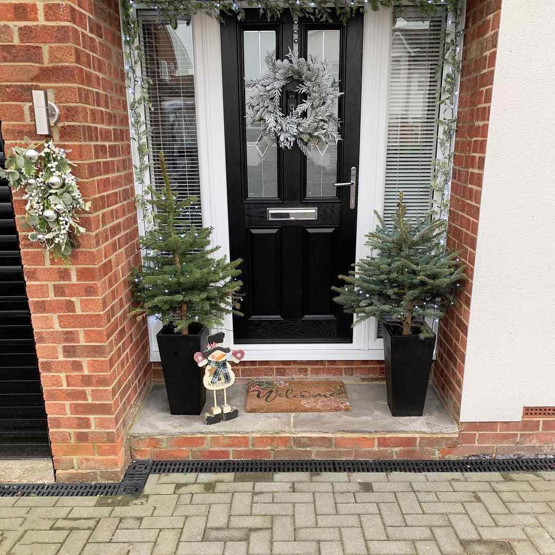 Black door with silver wreath