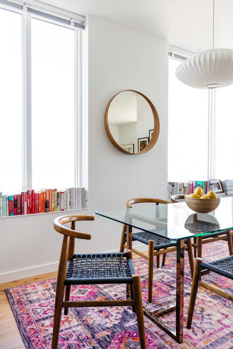 pink and purple rug in dining room