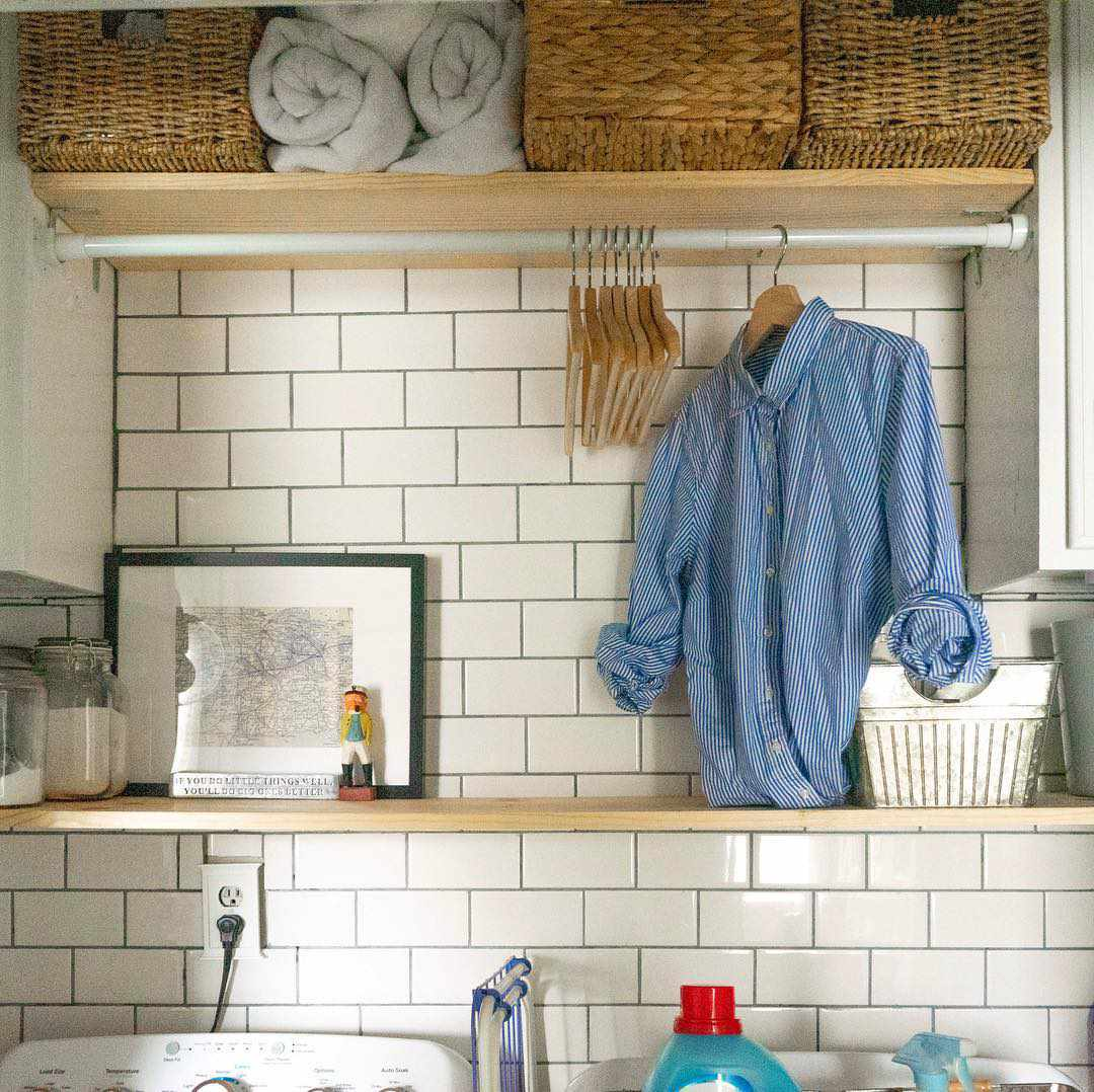 Small laundry room with subway tiles