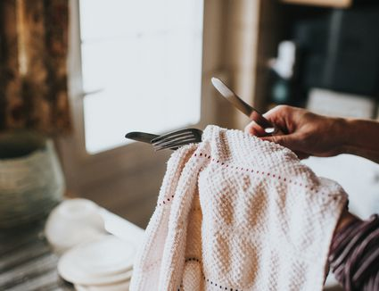 Woman drying Dishes - stock photo