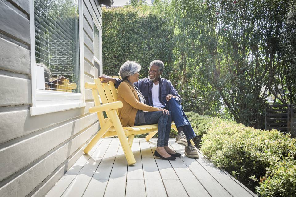 A senior couple on a porch