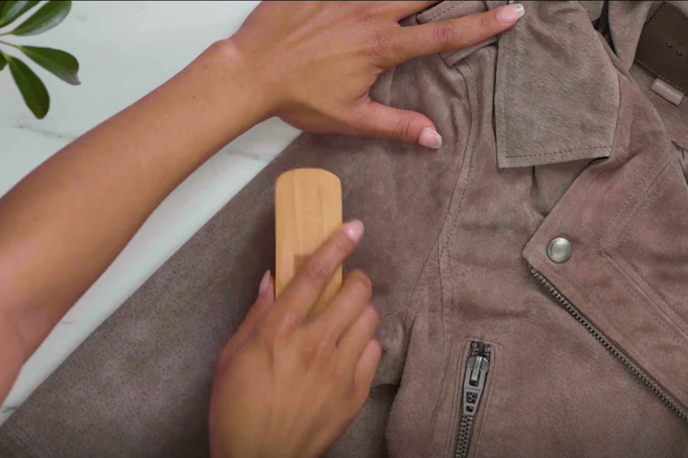 Brush out a suede jacket after wearing