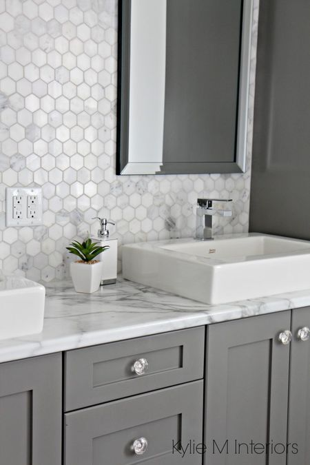 Bathroom With Fake Marble Countertop And Real Backsplash