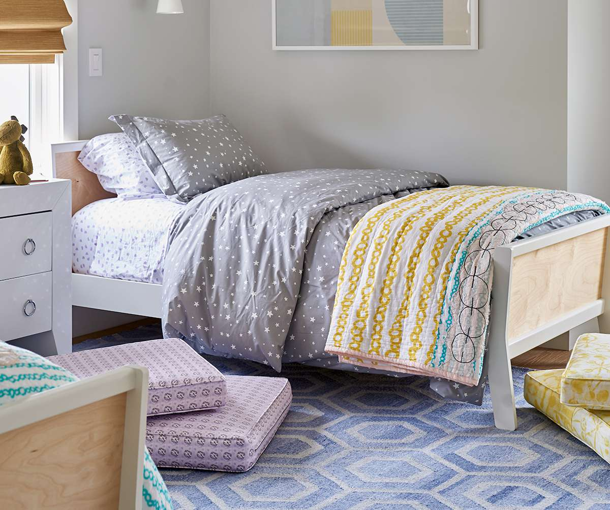 children's room with yellow, gray, and blue color scheme