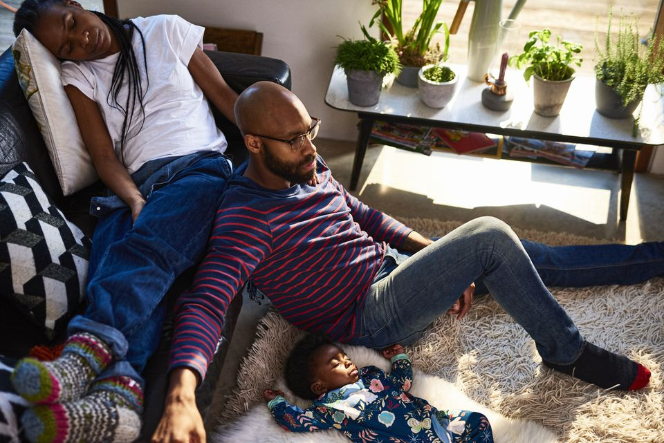 Parents with baby son resting