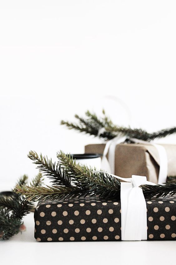 Polka dot gift wrapping with pine sprigs