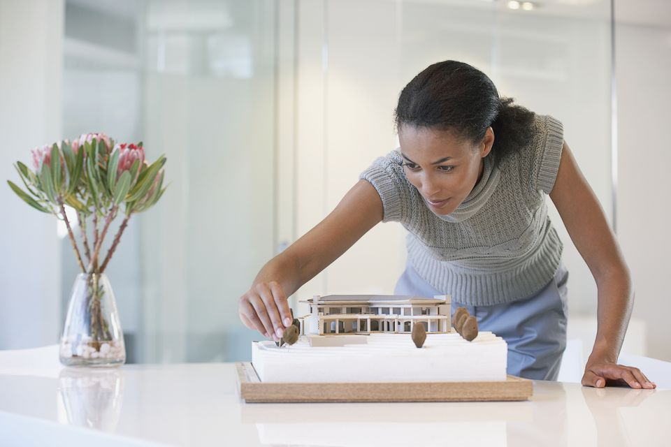 Designer using architectural model