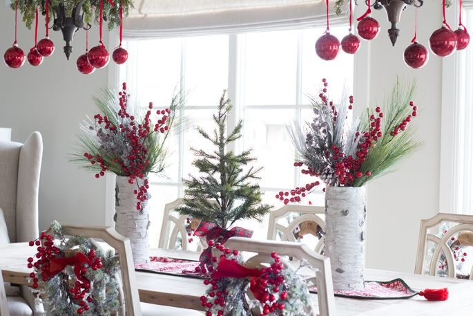 Birch and red table setting including foliage and chair decorations.