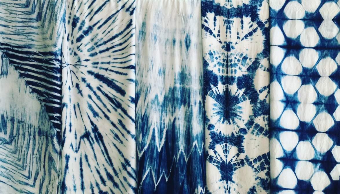 Indigo dyed textiles next to each other.