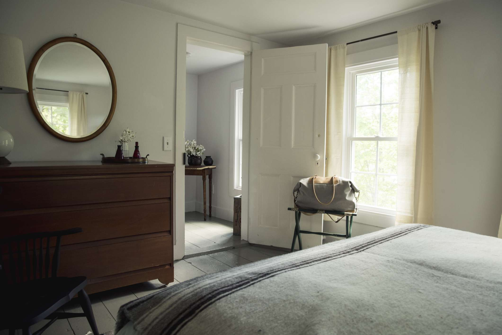 bedroom in a country house with a mirror